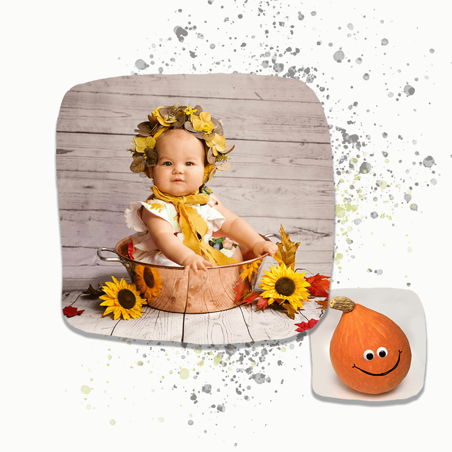 six month old baby sat in copper bowl and autumn scene.