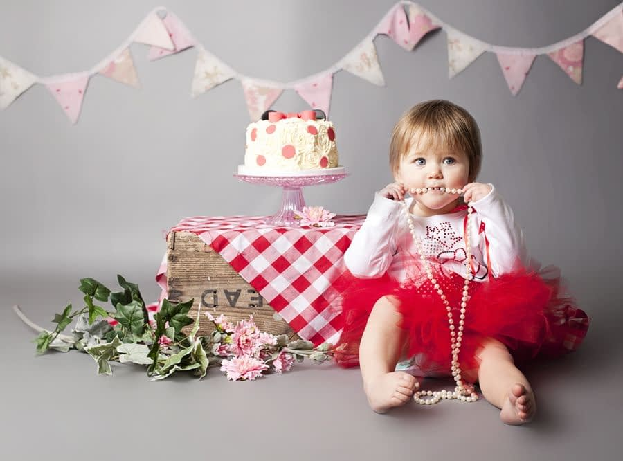 A photograph of a first birthday cake smash at PhotoBaby in Lancaster.