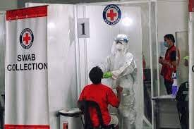 Red cross images of doctor and COVID patient.