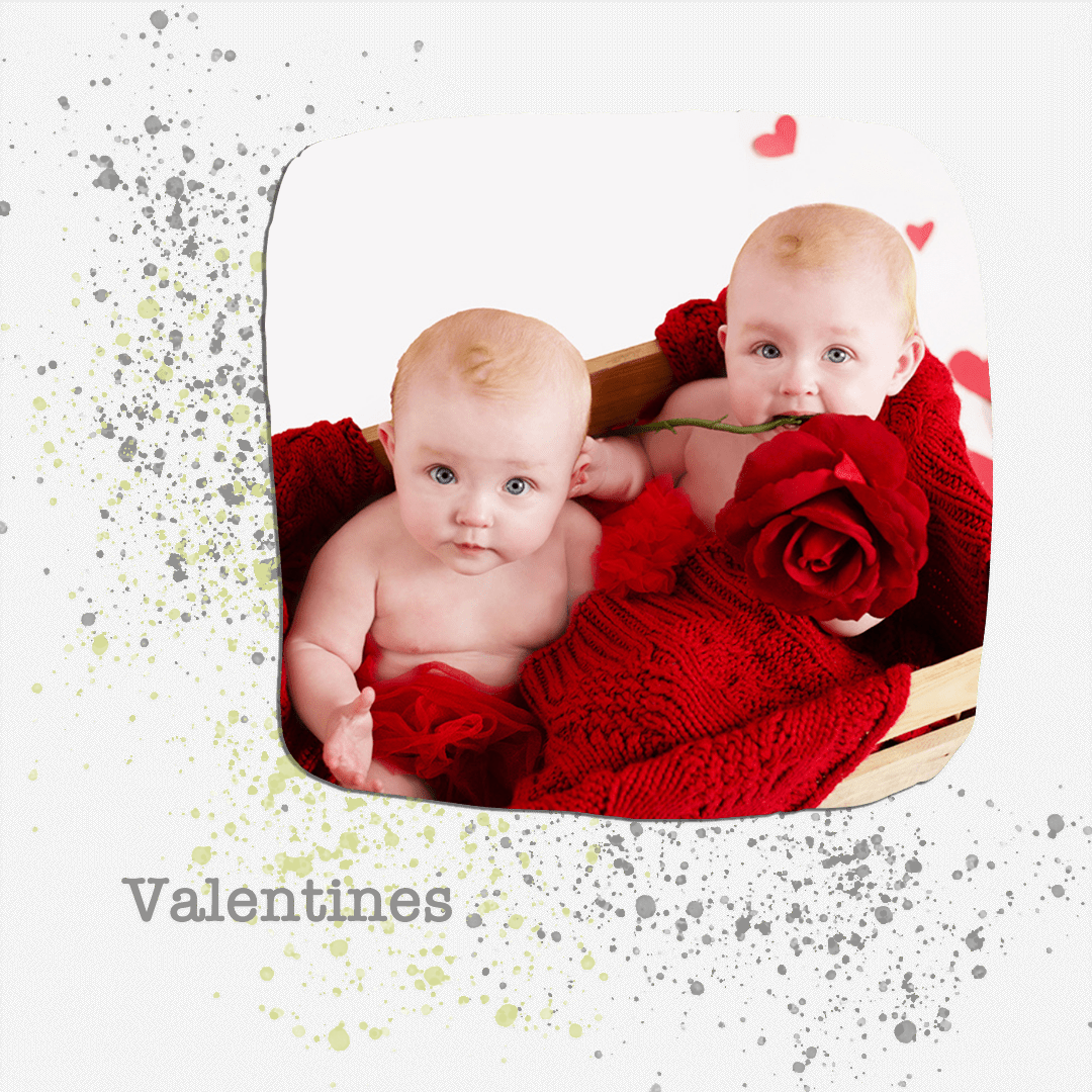 twin girls in a crate with a red rose.