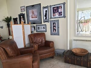 Photo Baby studio seating area with photographs on the wall behind.